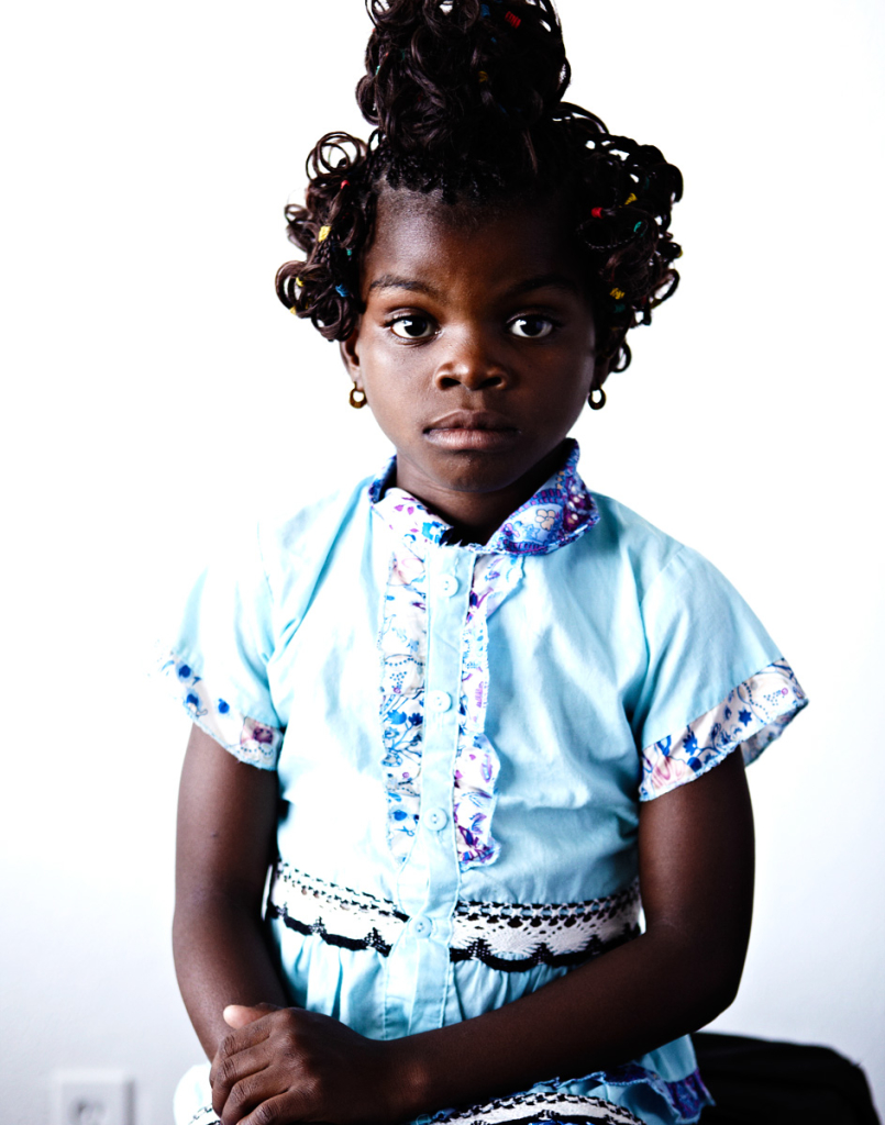 Small African girl poses for camera